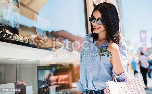 Modern young woman enjoying in shopping. Consumerism, fashion, lifestyle concept
