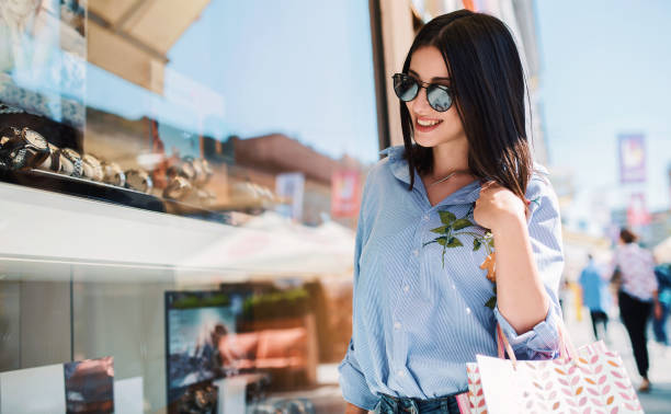 Happy woman in shopping. Consumerism, fashion, lifestyle concept stock photo