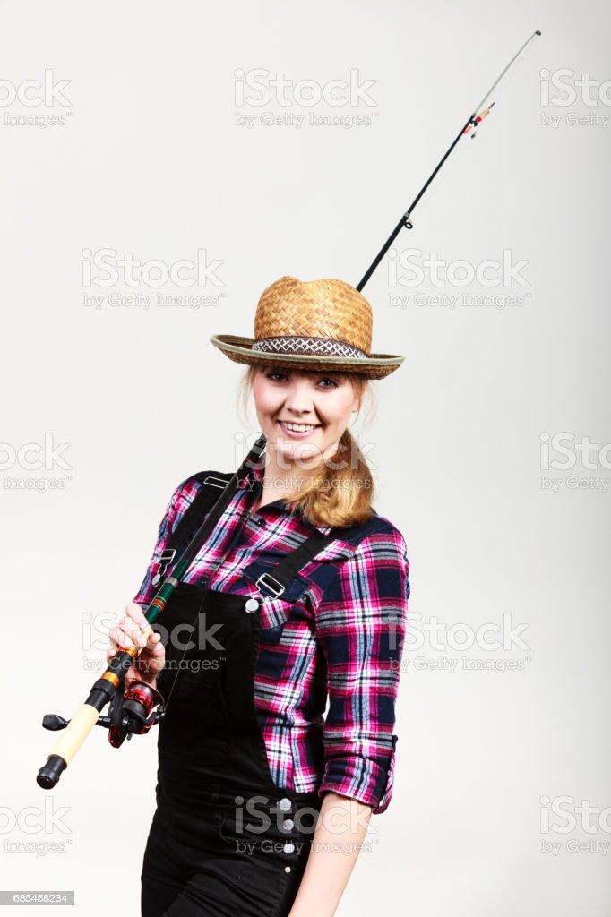 Happy woman in sun hat holding fishing rod foto de stock royalty-free