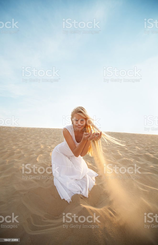 Happy woman in the dunes royalty-free stock photo