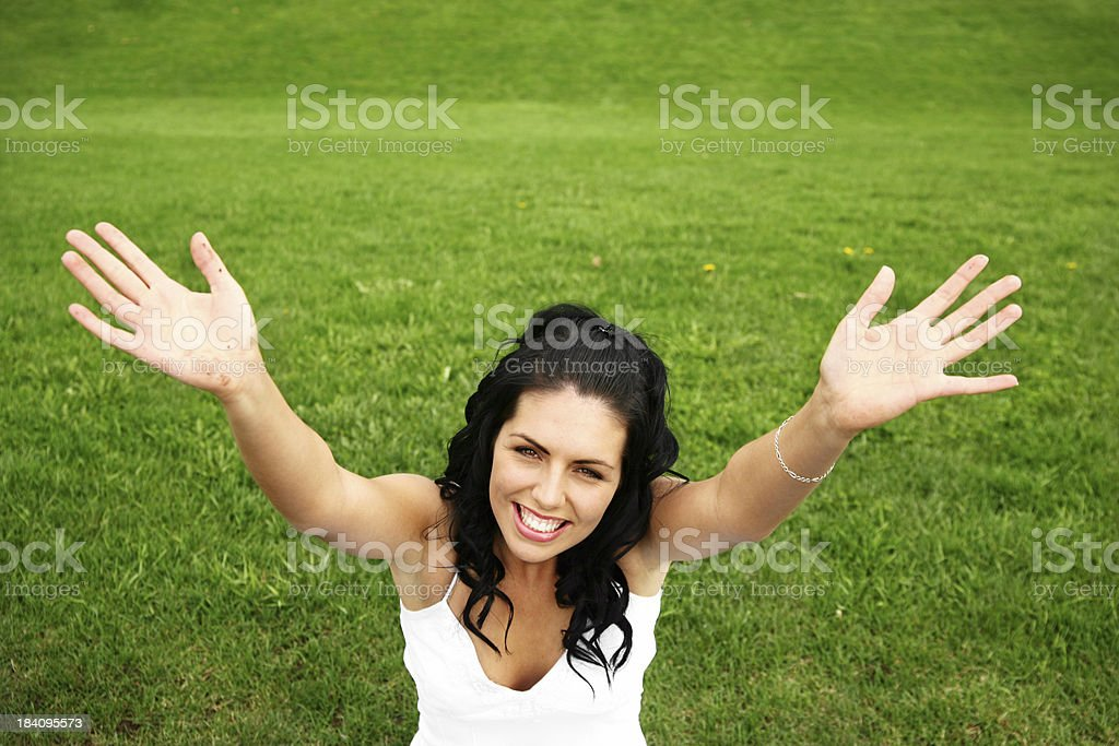 Happy woman in the grass royalty-free stock photo