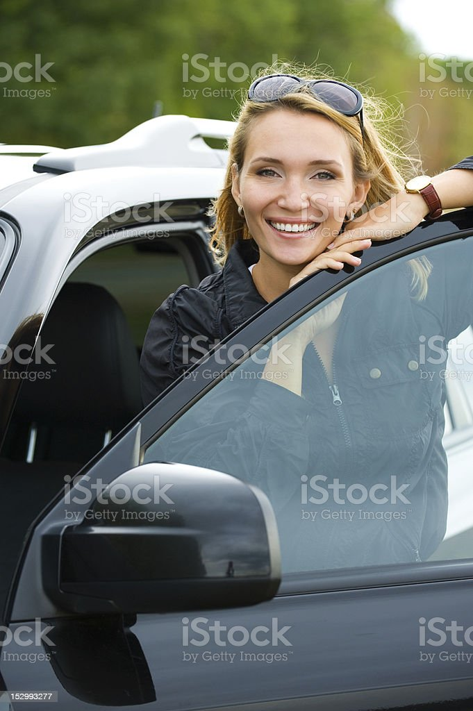 happy woman in the new car royalty-free stock photo