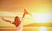 istock Happy woman  is back  opened his hands, enjoys sunset 481204136
