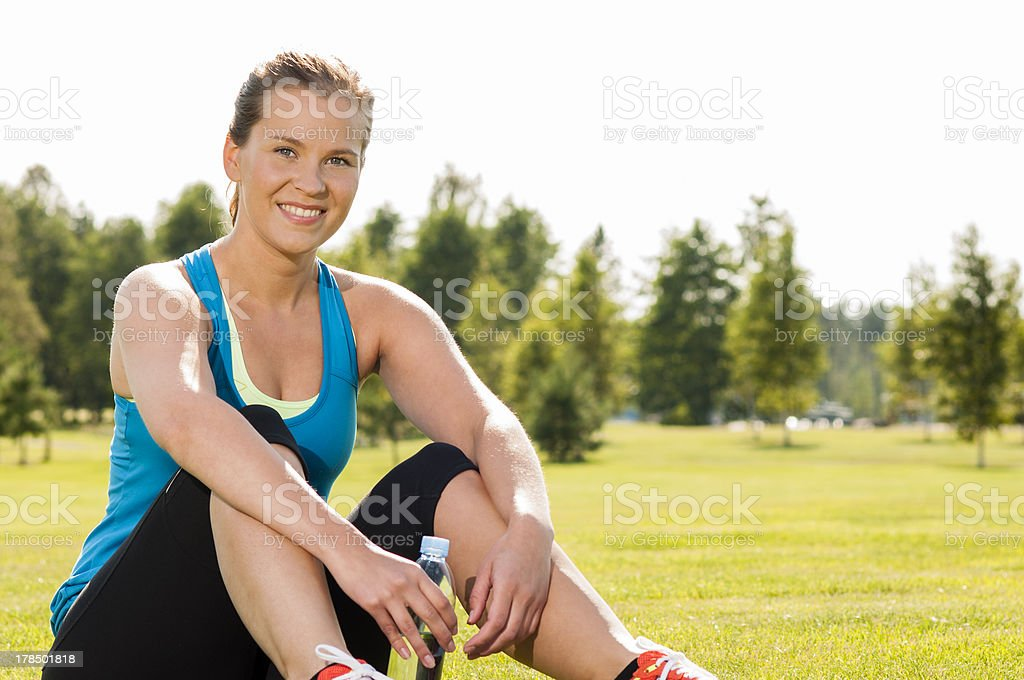Happy woman jogger training in the park. Healthy lifestyle. stock photo