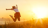 istock Happy woman  jump,  rejoices,  on sunset in nature 835976728