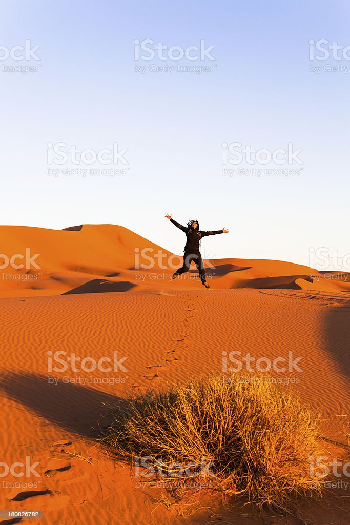 Happy Woman Jumping in the Desert of Sahara royalty-free stock photo