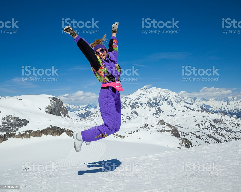 Happy woman jumping in the mountains stock photo