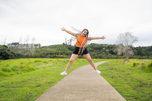 Pacific Islander woman enjoying outdoors in Auckland, New Zealand.
