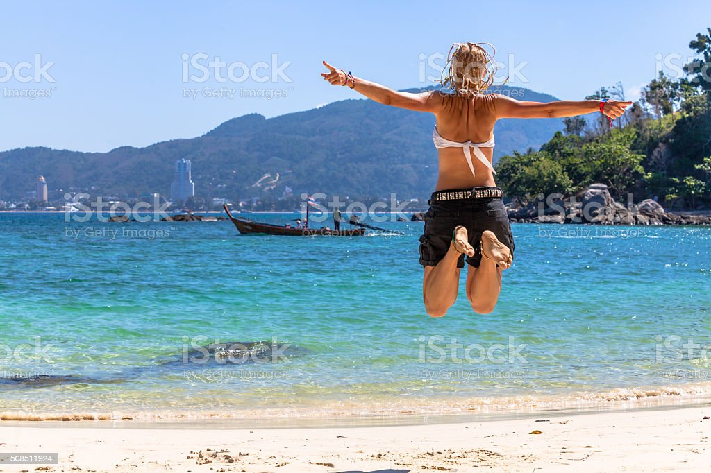 Happy woman jumping stock photo