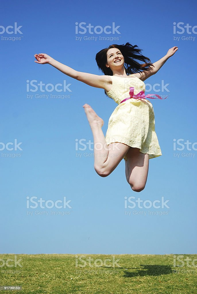 Happy woman jumping royalty-free stock photo