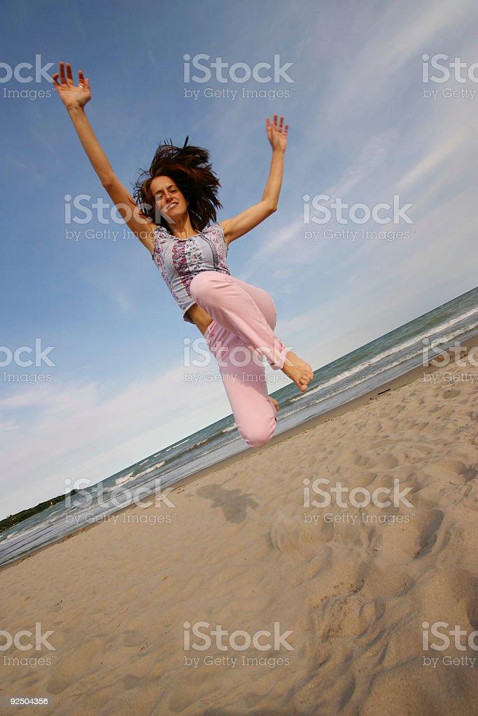 Happy woman jumping royalty-free stock photo