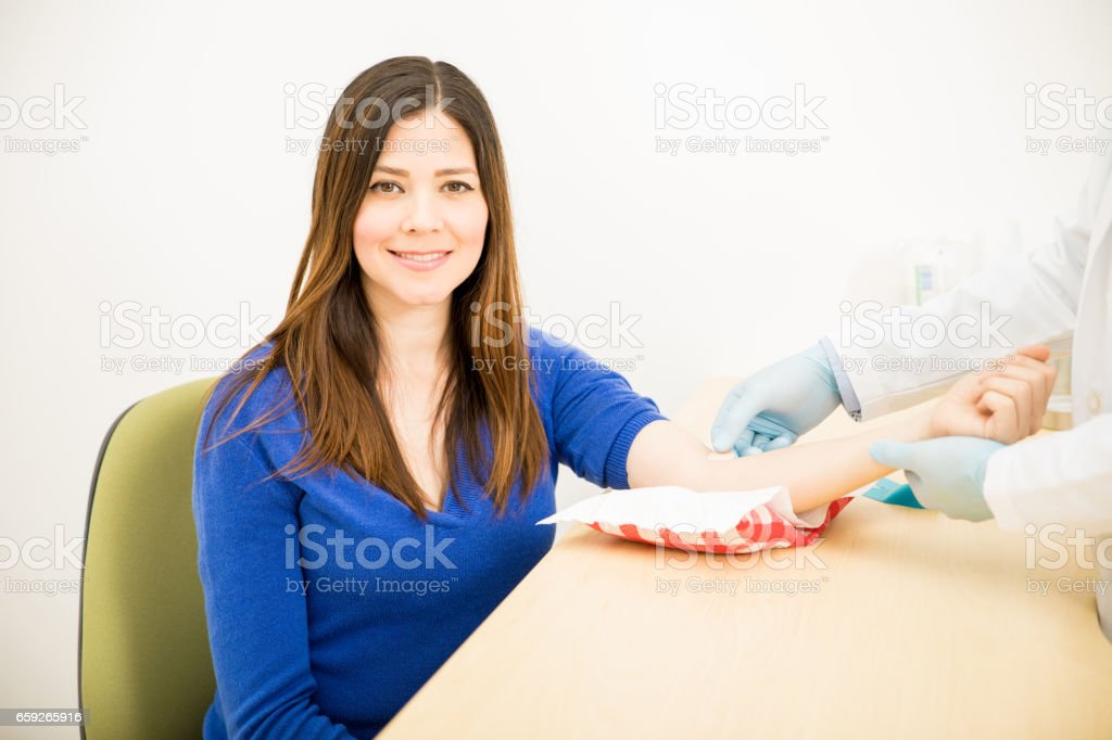 Happy woman just got a blood test stock photo