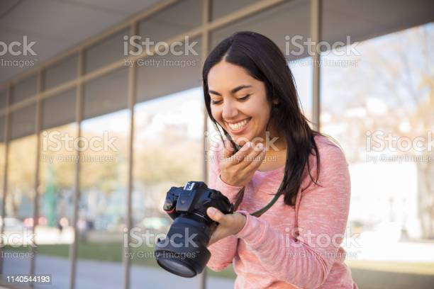 Happy woman looking at camera screen outdoors picture id1140544193?b=1&k=6&m=1140544193&s=612x612&h=8n pku 24lmqfypcer7mgzgriomz1 ueadvnkb2f43m=