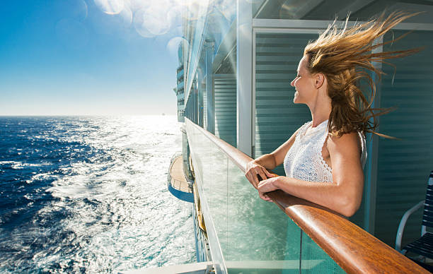 happy woman looking at sea from a cruise ship. - cruise stockfoto's en -beelden