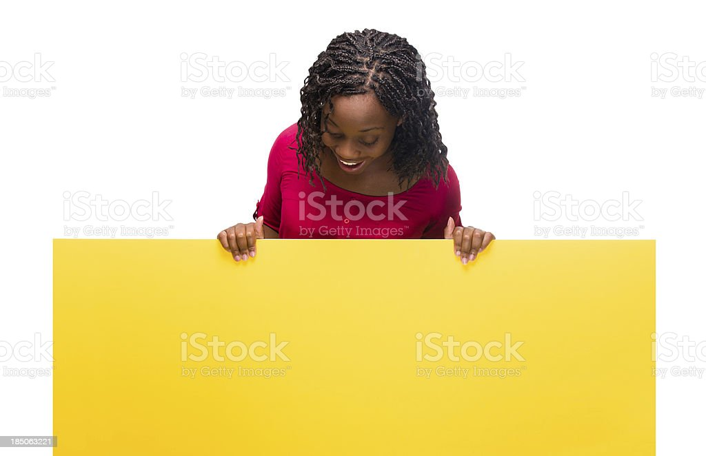 Happy woman looking at sign royalty-free stock photo