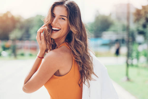 Happy woman looking back over shoulder stock photo