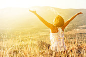 istock Happy woman meets sunrise in mountain 1027683304