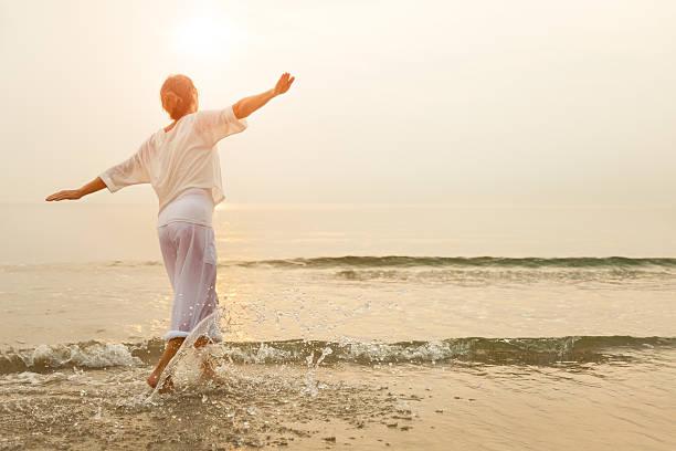 Happy woman on beach stock photo