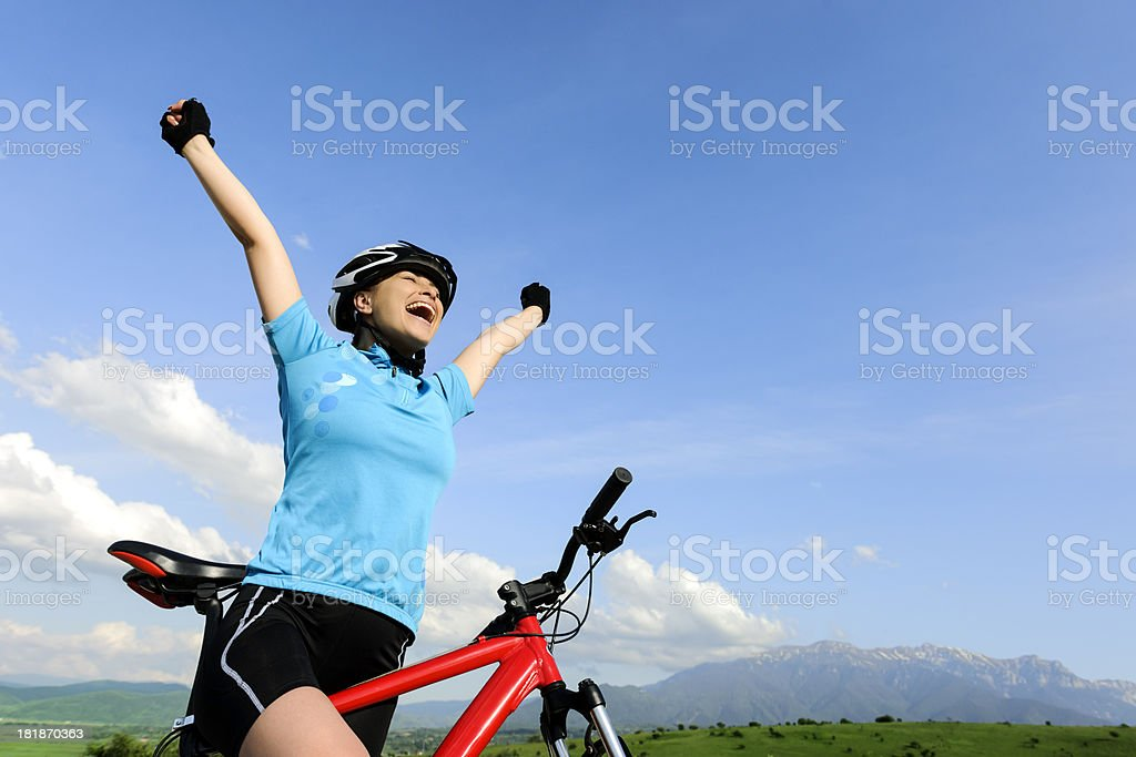 happy woman on bike royalty-free stock photo