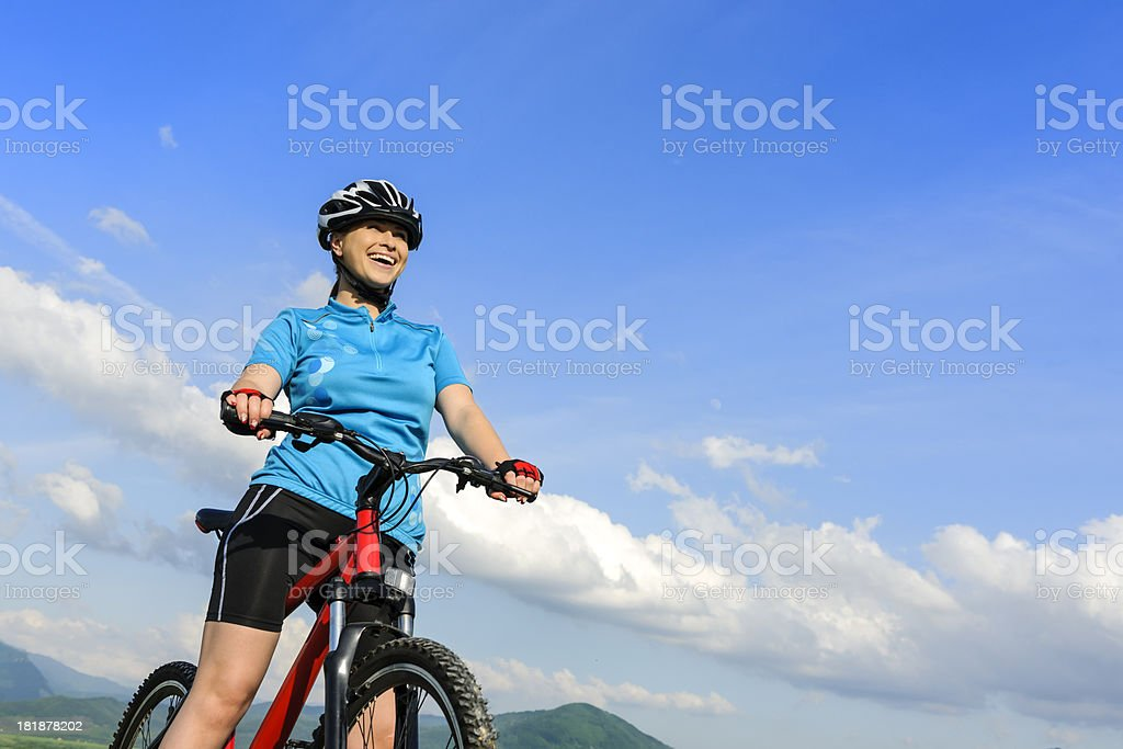 happy woman on bike royalty-free stock photo
