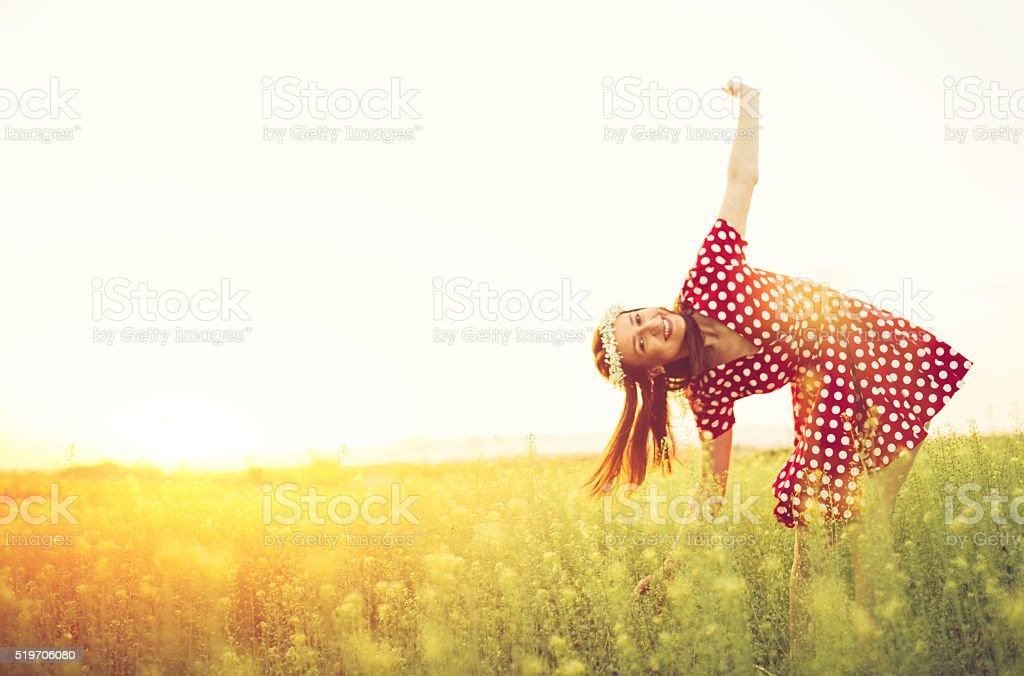 Happy woman on meadow stock photo