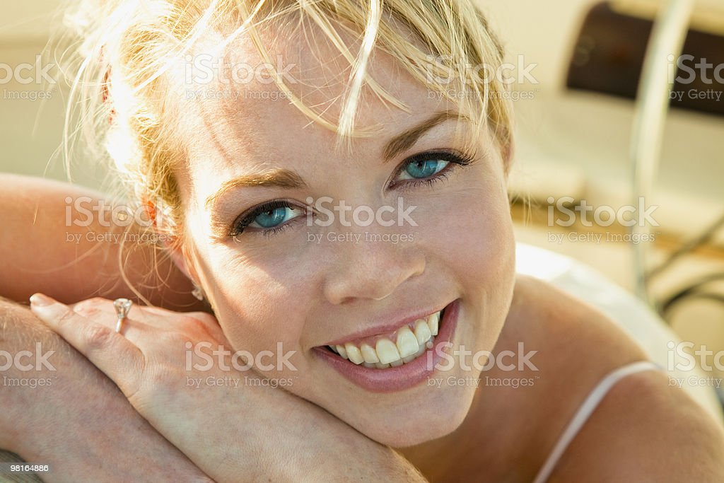 Happy woman on sailboat at sunset royalty-free stock photo