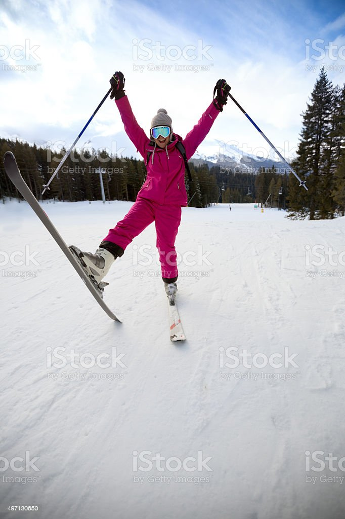 Happy woman on skis stock photo