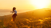 istock Happy woman   on sunset in nature iwith open hands 836685128
