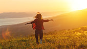 istock Happy woman   on sunset in nature iwith open hands 927402842