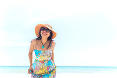 istock Happy woman on the beach in summer 681592350