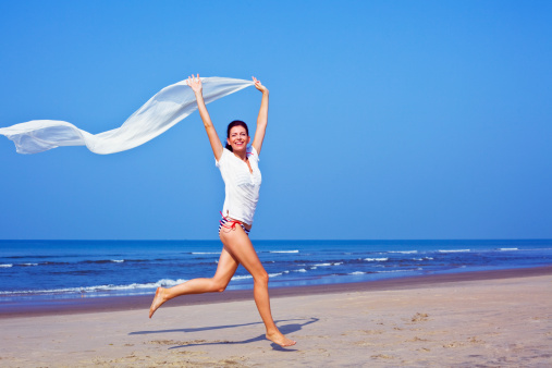 Happy Woman On The Beach Stock Photo - Download Image Now
