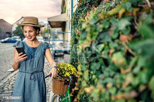 Woman Using Phone On Bicycle