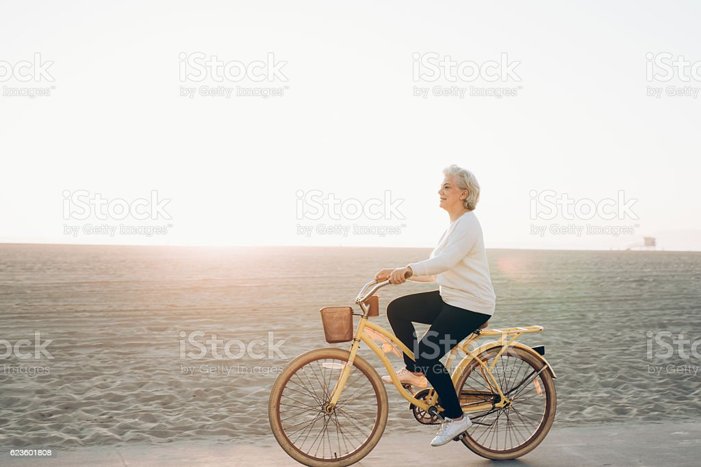 Happy woman on the bike stock photo