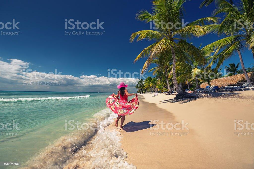 Happy woman on the tropical sandy beach, Saona island, Dominican stock photo