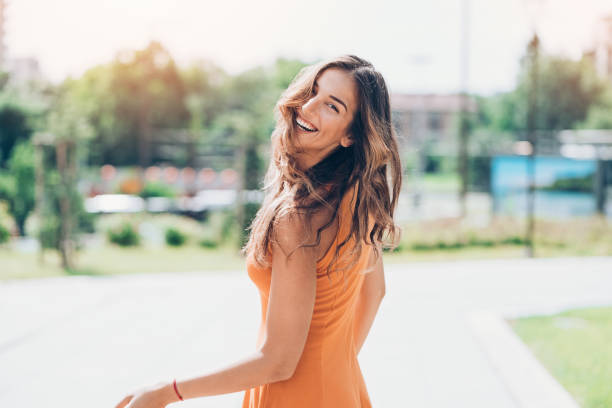 Happy woman outdoors on a sunny day stock photo