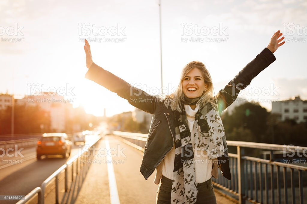 Happy woman outdoors stock photo