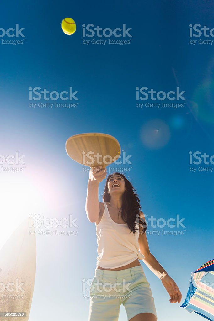Happy woman playing tennis on sunny day - foto stock