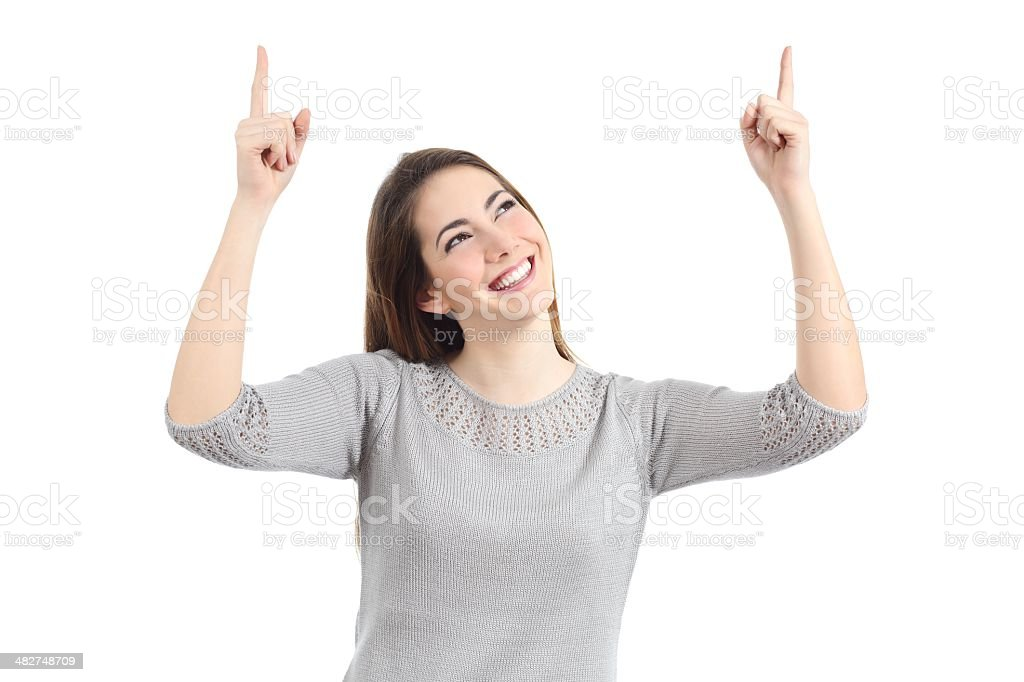 Happy woman pointing up with both hands stock photo