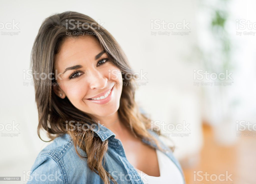 Happy woman portrait at home stock photo