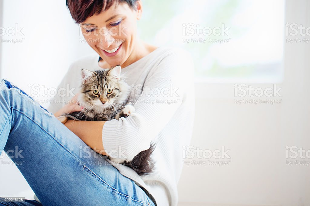 Happy Woman Portrait with her Cat stock photo