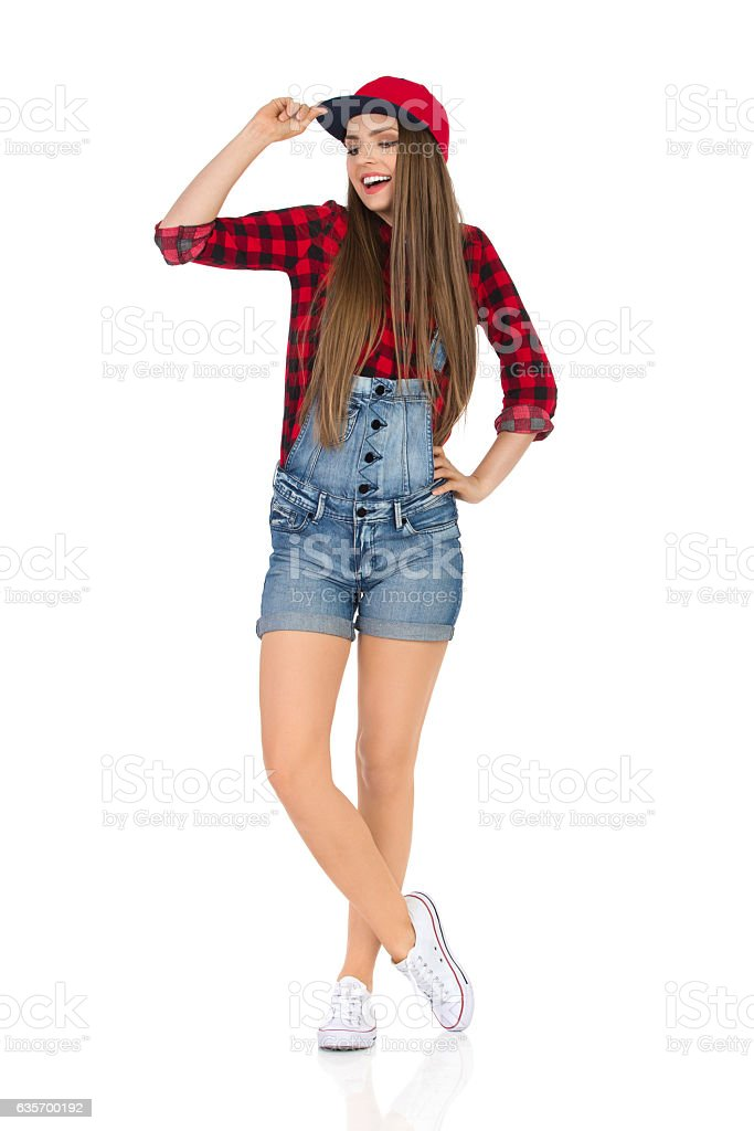 Happy Woman Posing In Red Full Cap royalty-free stock photo