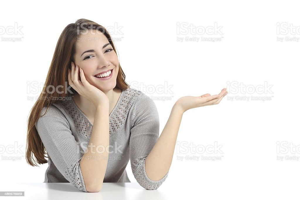 Happy woman presenting with open hand holding something blank stock photo