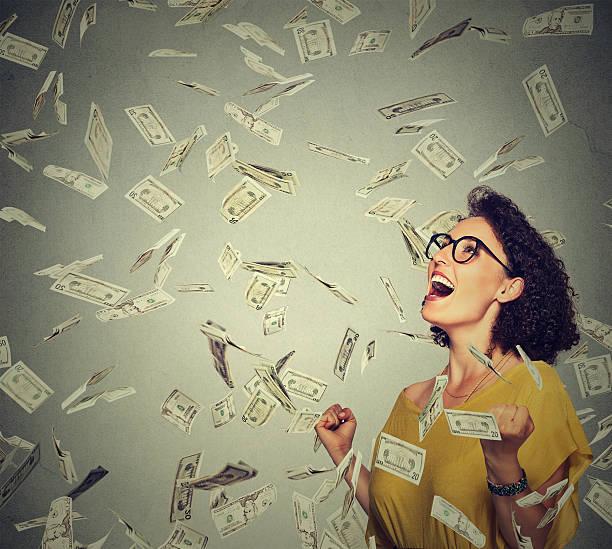 Happy woman pumping fists celebrates success under money rain picture id503764074?b=1&k=6&m=503764074&s=612x612&w=0&h=sieuht2plcsuveyszttc5vk9i53oarj4vvd0ju9lss0=