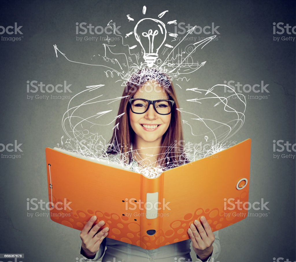 Happy woman reading a book stock photo