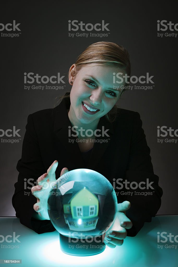 Happy Woman Real Estate Agent Predicting Future of House Market royalty-free stock photo