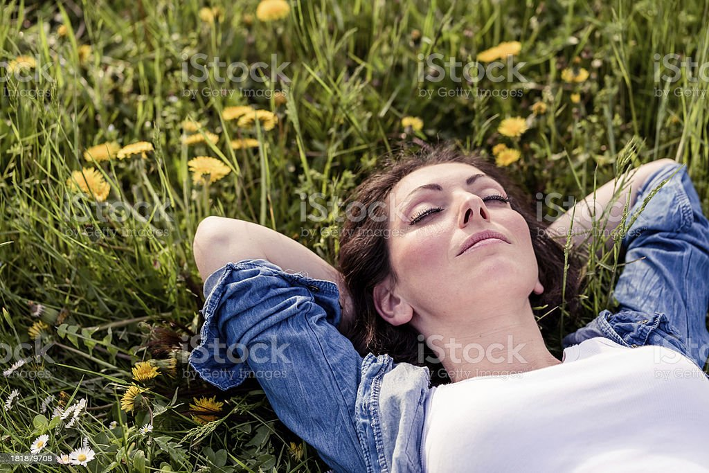 Happy Woman relaxing in a park bildbanksfoto