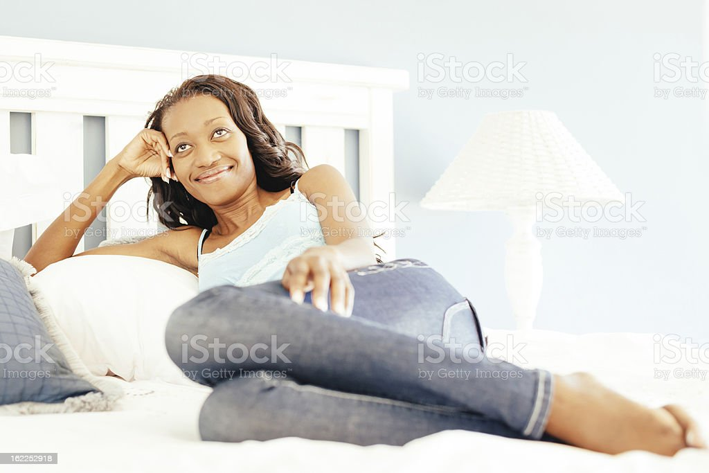 Happy Woman Relaxing on Bed,Positive Thinking royalty-free stock photo