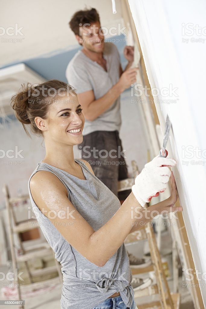 Happy woman renovating flat stock photo