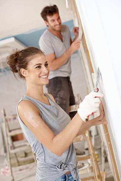 Happy woman renovating flat stock photo