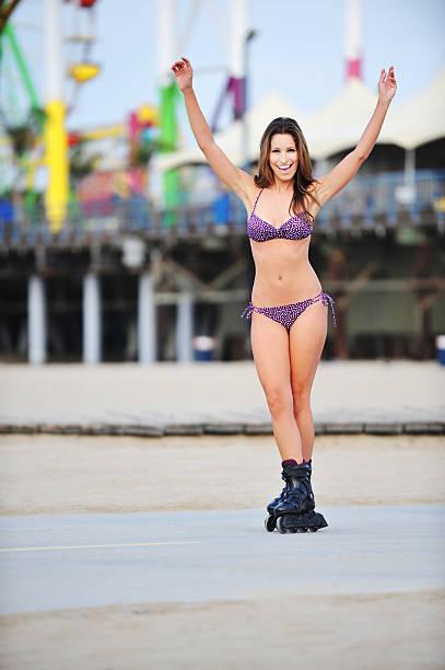 Royalty Free Young Woman Rollerblading In Bikini On Beach ...